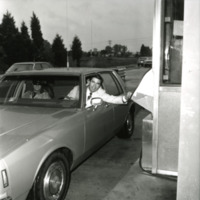 Virginia Governor Charles S. Robb opens the Dulles Toll Road by depositing coin at toll booth